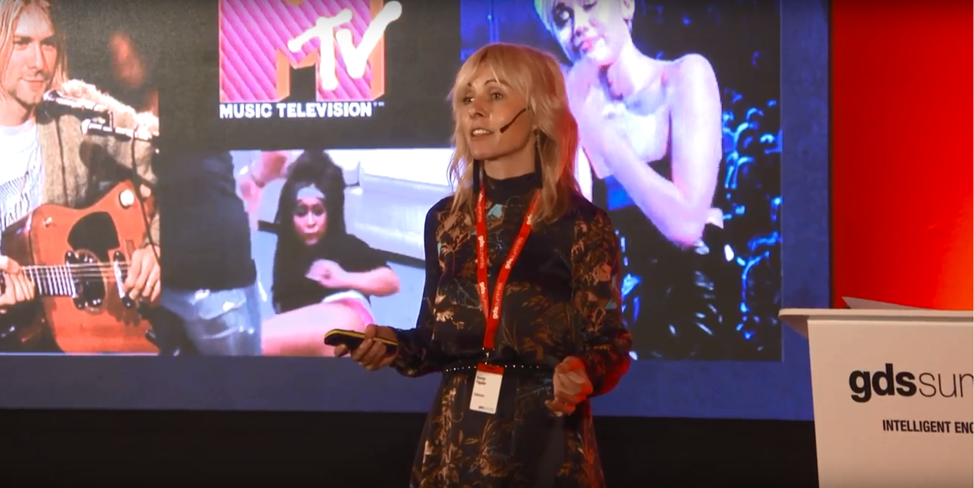 Kerry Taylor in front of projector with MTV slogan