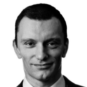 headshot of Piotr Piskorski