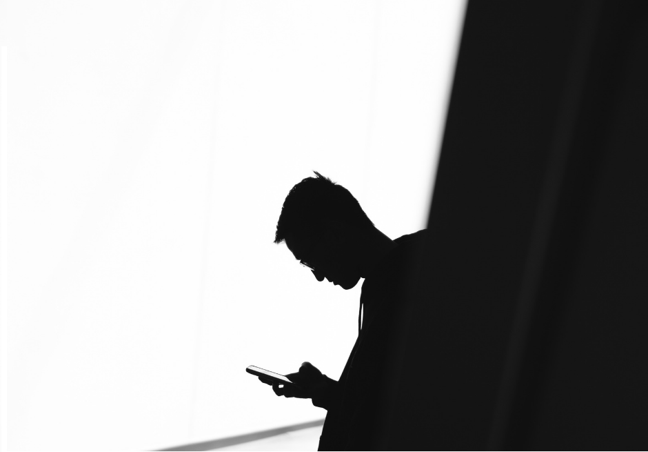 man on phone silhouette