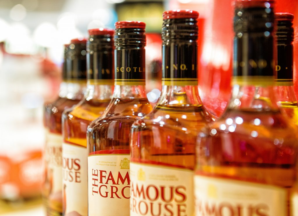 Row of bottles of THE FAMOUS GROUSE Scottish Whiskey