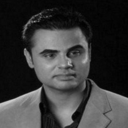 headshot of Shahbaz Alibaig