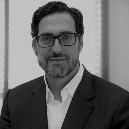 headshot of Alfonso Ayuso