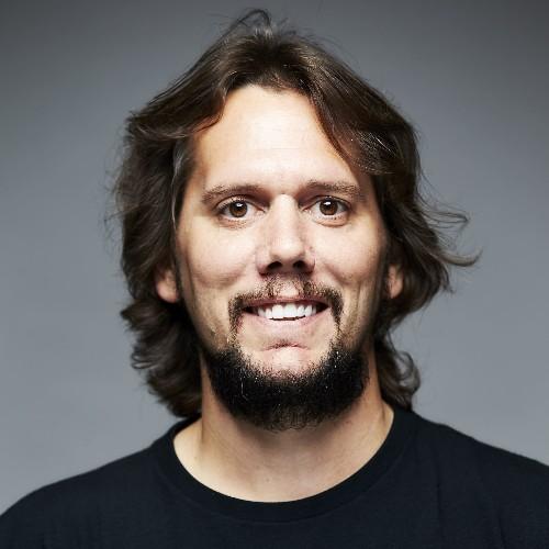 headshot of Nikolas Acheson