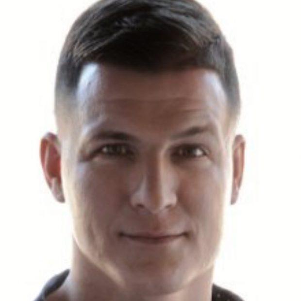 headshot of Chris Buck